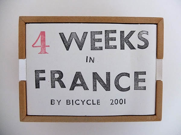 A unique book of collected objects from the roads of France during a 4 week cycle ride. Wooden box containing paper sleeve containing a concertina of collected objects. 15 x 10.5 x 8 cm